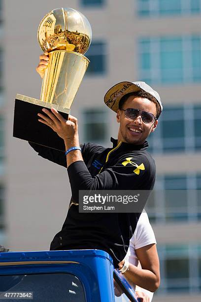 Stephen Curry of the Golden State Warriors displays the Larry O'Brien NBA Championship Trophy during the Golden State Warriors Victory Parade in...