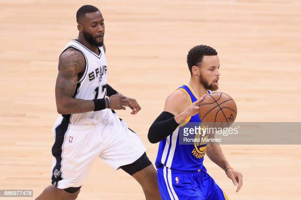 Stephen Curry of the Golden State Warriors dribbles against Jonathon Simmons of the San Antonio Spurs in the first half during Game Four of the 2017...