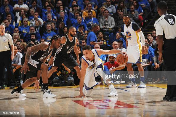 Stephen Curry of the Golden State Warriors dribbles against Kawhi Leonard of the San Antonio Spurs on January 25 2016 at Oracle Arena in Oakland...