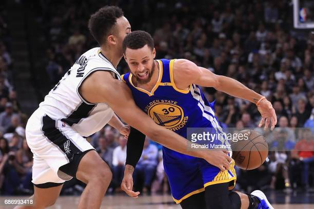 Stephen Curry of the Golden State Warriors dribbles against Kyle Anderson of the San Antonio Spurs in the first half during Game Four of the 2017 NBA...