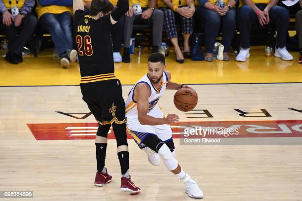 Stephen Curry of the Golden State Warriors dribbles around Kyle Korver of the Cleveland Cavaliers in Game Five of the 2017 NBA Finals on June 12 2017...