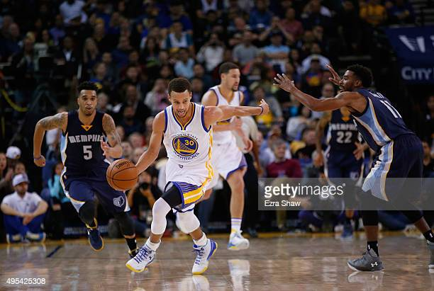 Stephen Curry of the Golden State Warriors dribbles downcourt after stealing the ball from Mike Conley of the Memphis Grizzlies at ORACLE Arena on...