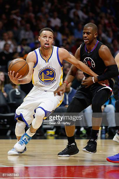 Stephen Curry of the Golden State Warriors dribbles past Chris Paul of the Los Angeles Clippers during the first half of a game at Staples Center on...
