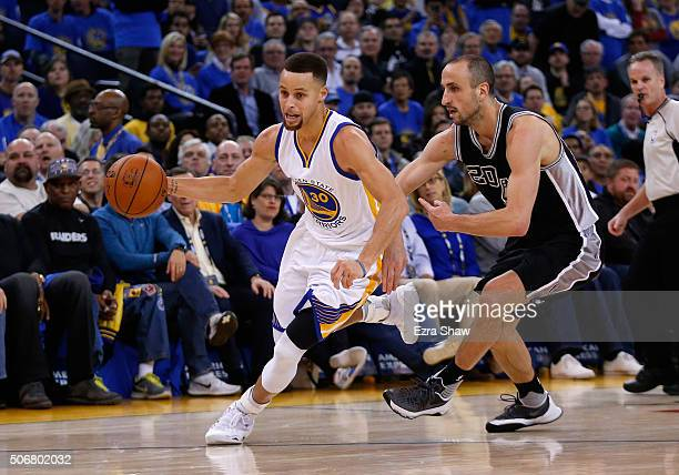 Stephen Curry of the Golden State Warriors dribbles past Manu Ginobili of the San Antonio Spurs at ORACLE Arena on January 25 2016 in Oakland...