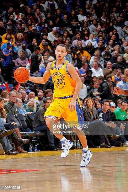 Stephen Curry of the Golden State Warriors dribbles the ball against the Atlanta Hawks on February 25 2011 at Oracle Arena in Oakland California NOTE...