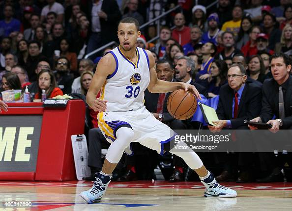 Stephen Curry of the Golden State Warriors dribbles the ball along the side line during the NBA game against the Los Angeles Clippers at Staples...