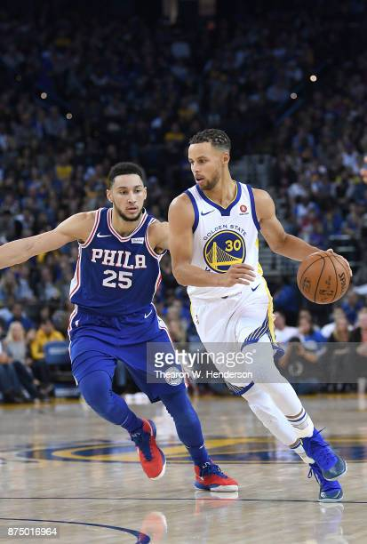 Stephen Curry of the Golden State Warriors dribbles the ball past Ben Simmons of the Philadelphia 76ers during an NBA basketball game at ORACLE Arena...