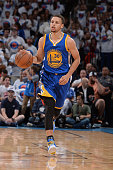 Stephen Curry of the Golden State Warriors dribbles the ball up court against the Oklahoma City Thunder in Game Four of the Western Conference Finals...