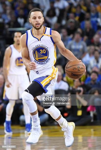 Stephen Curry of the Golden State Warriors dribbles the ball up court against the Minnesota Timberwolves during an NBA basketball game at ORACLE...