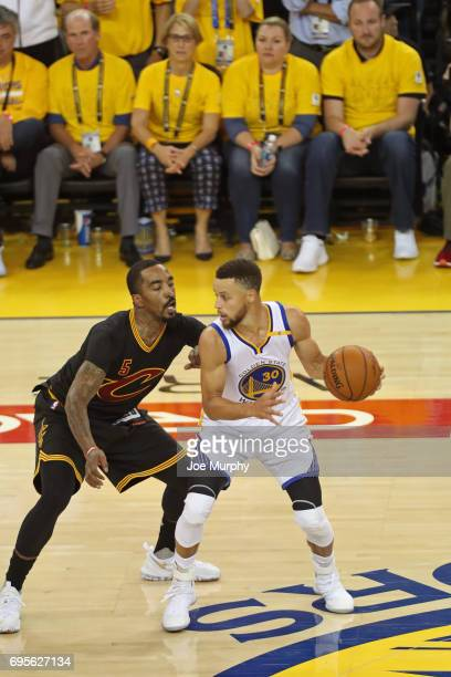 Stephen Curry of the Golden State Warriors dribbles the ball while guarded by JR Smith of the Cleveland Cavaliers in Game Five of the 2017 NBA Finals...