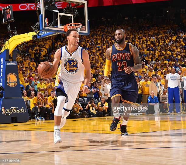 Stephen Curry of the Golden State Warriors dribbles up court against the Cleveland Cavaliers at the Oracle Arena During Game Five of the 2015 NBA...