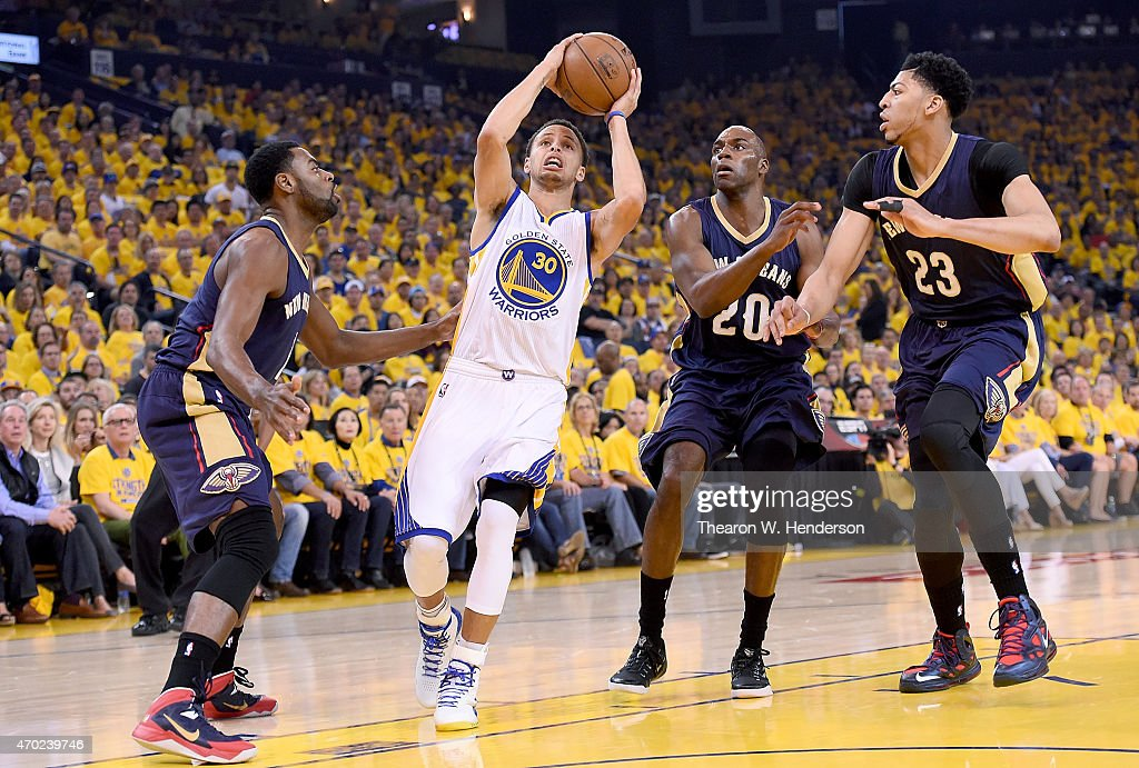 Stephen Curry #30 of the Golden State Warriors drive on Anthony Davis #23, Tyreke Evans #1 and Quincy Pondexter #20 of the New Orleans Pelicans in the first quarter during the first round of the 2015 NBA Playoffs at ORACLE Arena on April 18, 2015 in Oakland, California.