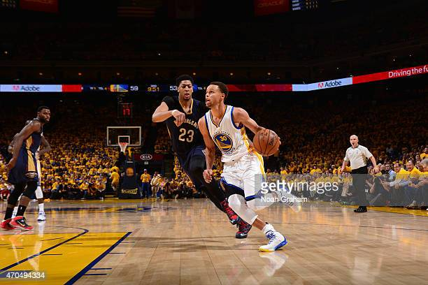 Stephen Curry of the Golden State Warriors drives against Anthony Davis of the New Orleans Pelicans in Game Two of the Western Conference...