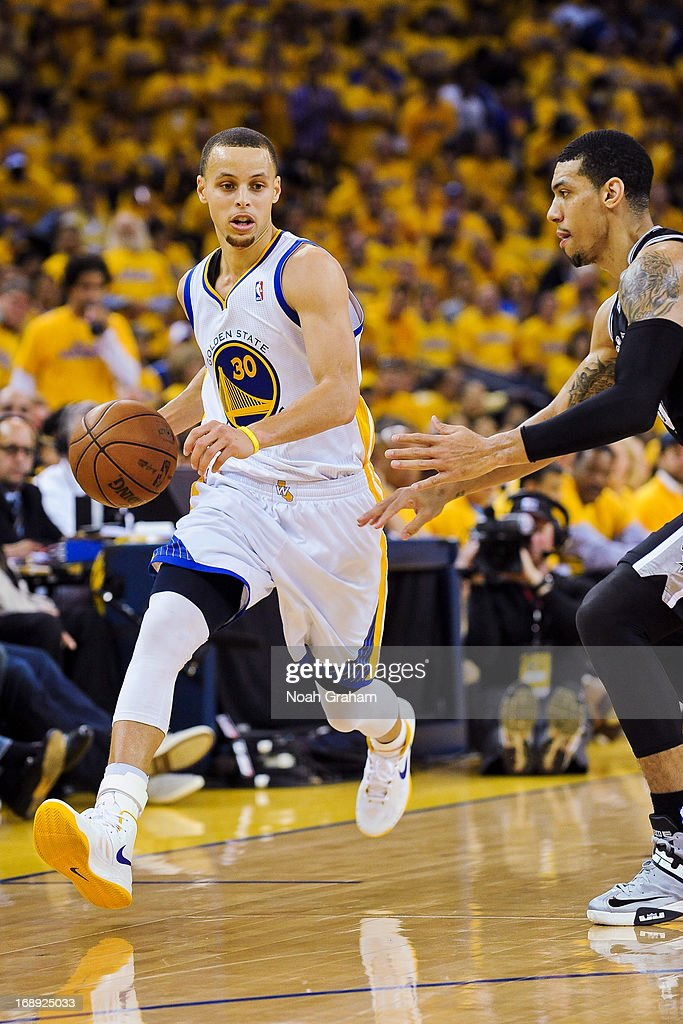 Stephen Curry #30 of the Golden State Warriors drives against Danny Green #4 of the San Antonio Spurs in Game Six of the Western Conference Semifinals during the 2013 NBA Playoffs on May 16, 2013 at Oracle Arena in Oakland, California.