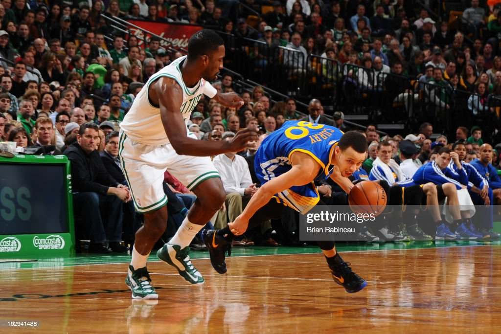 Stephen Curry #30 of the Golden State Warriors drives against Jeff Green #8 of the Boston Celtics on March 1, 2013 at the TD Garden in Boston, Massachusetts.
