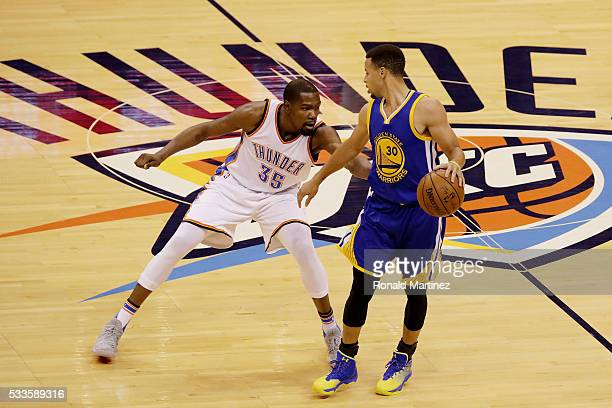 Stephen Curry of the Golden State Warriors drives against Kevin Durant of the Oklahoma City Thunder in the first quater in game three of the Western...