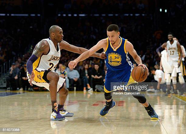 Stephen Curry of the Golden State Warriors drives against Kobe Bryant of the Los Angeles Lakers at Staples Center March 6 in Los Angeles California...
