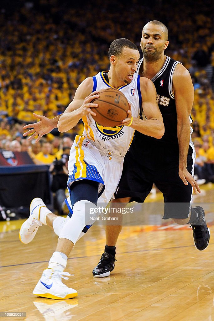 Stephen Curry #30 of the Golden State Warriors drives against Tony Parker #9 of the San Antonio Spurs in Game Six of the Western Conference Semifinals during the 2013 NBA Playoffs on May 16, 2013 at Oracle Arena in Oakland, California.