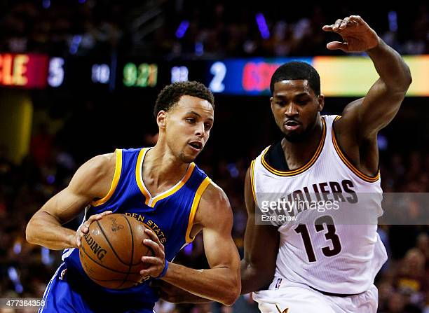 Stephen Curry of the Golden State Warriors drives against Tristan Thompson of the Cleveland Cavaliers in the first quarter during Game Six of the...