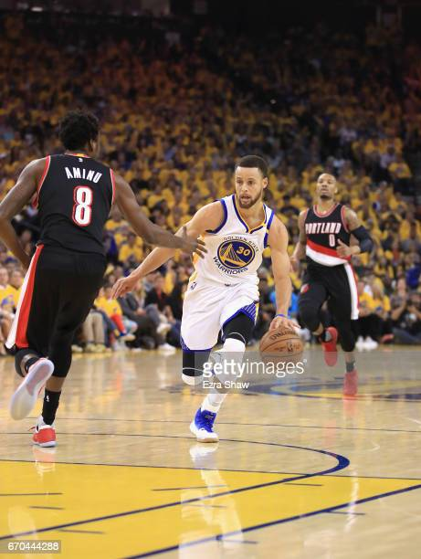 Stephen Curry of the Golden State Warriors drives on AlFarouq Aminu of the Portland Trail Blazers during Game Two of the Western Conference...