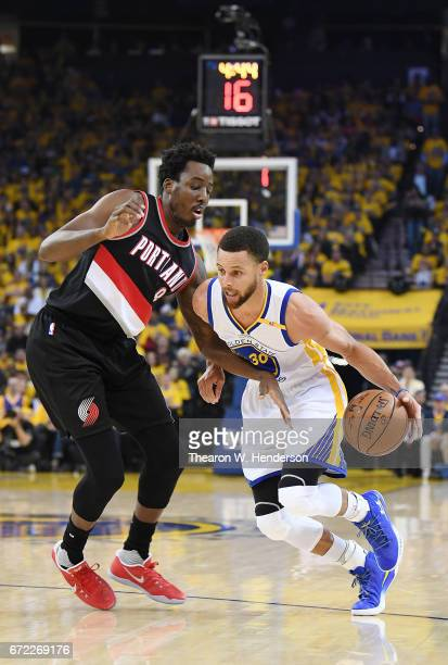 Stephen Curry of the Golden State Warriors drives on AlFarouq Aminu of the Portland Trail Blazers in the first quarter during Game One of the first...