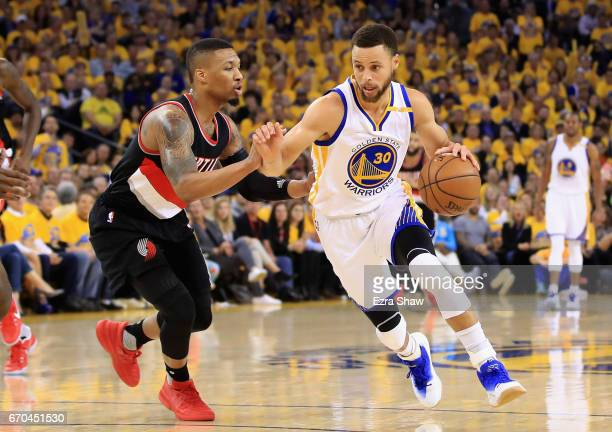Stephen Curry of the Golden State Warriors drives on Damian Lillard of the Portland Trail Blazers Game Two of the Western Conference Quarterfinals...