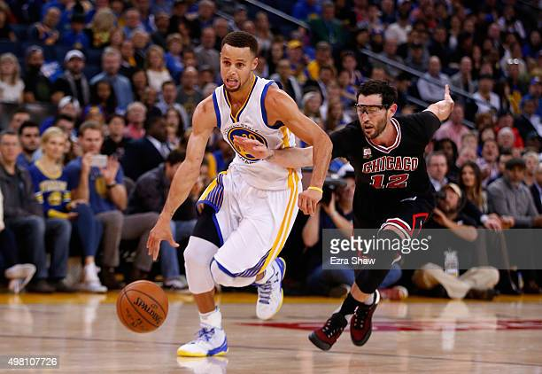 Stephen Curry of the Golden State Warriors drives on Kirk Hinrich of the Chicago Bulls at ORACLE Arena on November 20 2015 in Oakland California NOTE...