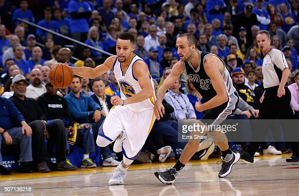 Stephen Curry of the Golden State Warriors drives on Manu Ginobili of the San Antonio Spurs at ORACLE Arena on January 25 2016 in Oakland California...