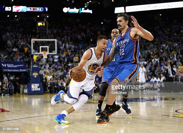 Stephen Curry of the Golden State Warriors drives on Steven Adams of the Oklahoma City Thunder at ORACLE Arena on March 3 2016 in Oakland California...