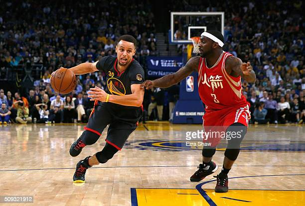 Stephen Curry of the Golden State Warriors drives on Ty Lawson of the Houston Rockets at ORACLE Arena on February 9 2016 in Oakland California NOTE...