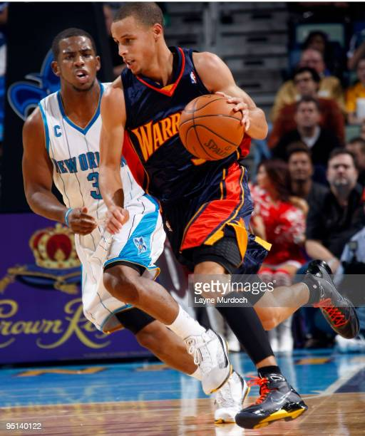 Stephen Curry of the Golden State Warriors drives past Chris Paul of the New Orleans Hornets on December 23 2009 at the New Orleans Arena in New...