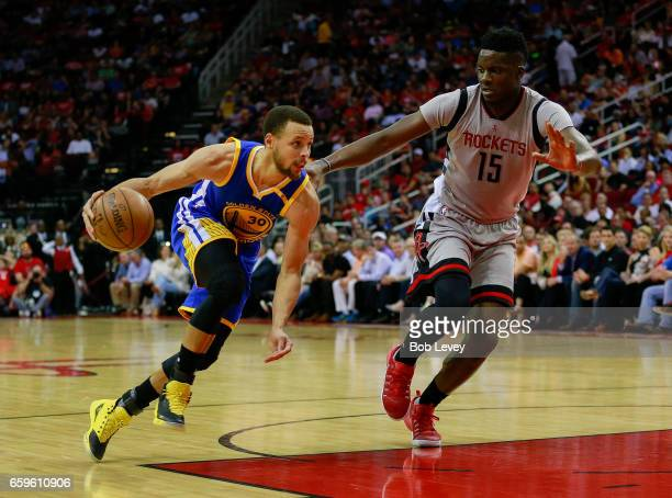 Stephen Curry of the Golden State Warriors drives past Clint Capela of the Houston Rockets during the third quarter at Toyota Center on March 28 2017...
