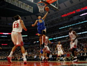 Stephen Curry of the Golden State Warriors drives to the basket surrounded by Joakim Noah Taj Gibson Derrick Rose and Loul Deng of the Chicago Bulls...