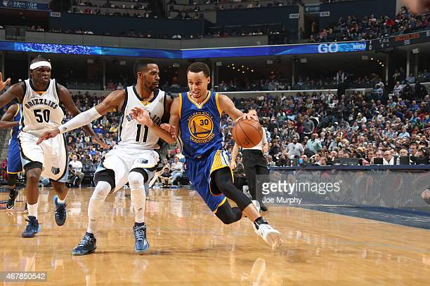 Stephen Curry of the Golden State Warriors drives to the basket against Mike Conley of the Memphis Grizzlies on March 27 2015 at FedExForum in...
