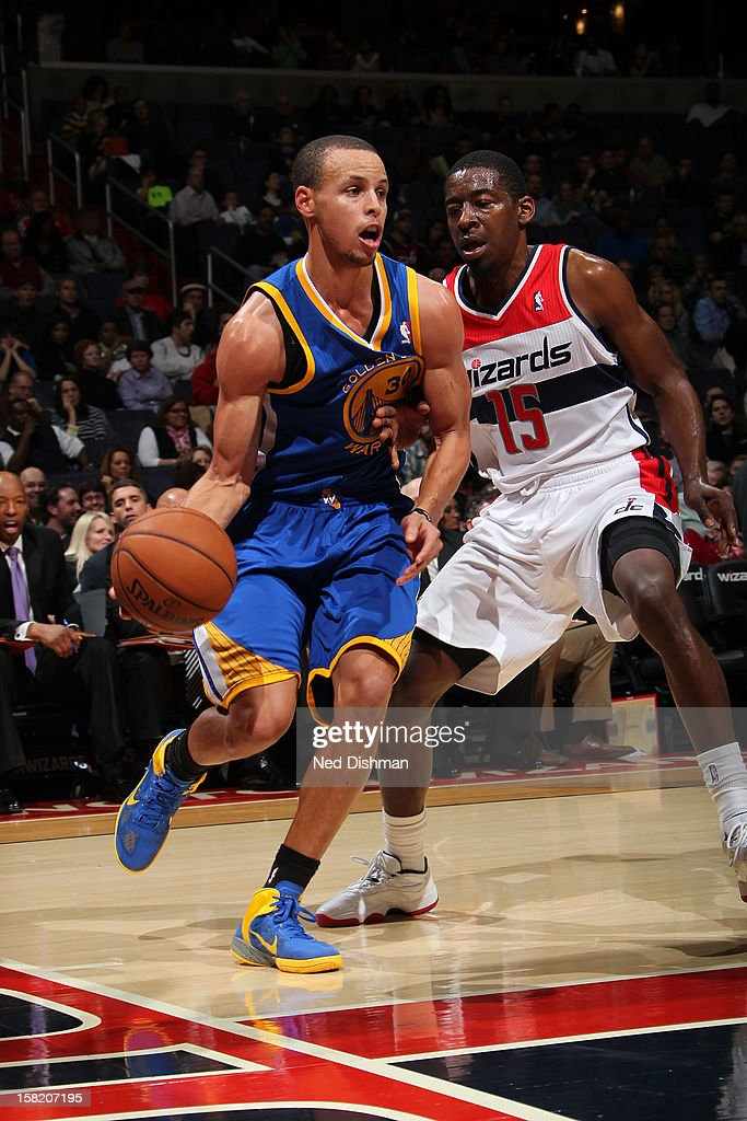 Stephen Curry #30 of the Golden State Warriors drives to the basket against <a gi-track='captionPersonalityLinkClicked' href=/galleries/search?phrase=Jordan+Crawford&family=editorial&specificpeople=4779380 ng-click='$event.stopPropagation()'>Jordan Crawford</a> #15 of the Washington Wizards on December 8, 2012 at the Verizon Center in Washington, DC.