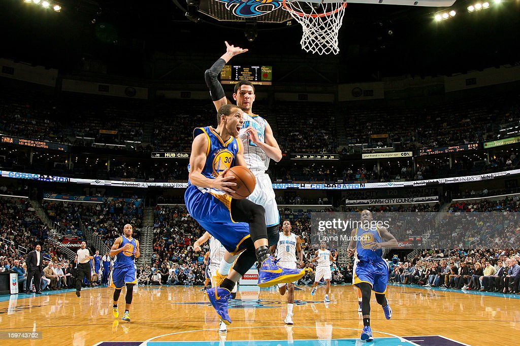 Stephen Curry #30 of the Golden State Warriors drives to the basket against <a gi-track='captionPersonalityLinkClicked' href=/galleries/search?phrase=Austin+Rivers&family=editorial&specificpeople=7117574 ng-click='$event.stopPropagation()'>Austin Rivers</a> #25 of the New Orleans Hornets on January 19, 2013 at the New Orleans Arena in New Orleans, Louisiana.