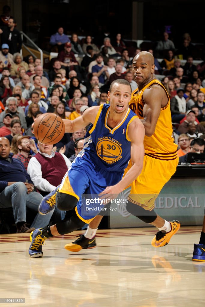 Stephen Curry #30 of the Golden State Warriors drives to the basket against <a gi-track='captionPersonalityLinkClicked' href=/galleries/search?phrase=Jarrett+Jack&family=editorial&specificpeople=208109 ng-click='$event.stopPropagation()'>Jarrett Jack</a> #1 of the Cleveland Cavaliers at The Quicken Loans Arena on December 29, 2013 in Cleveland, Ohio.