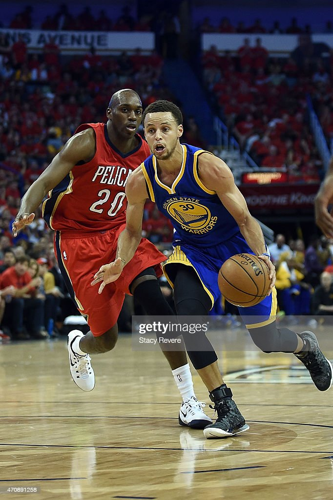 Stephen Curry of the Golden State Warriors drives to the basket against Quincy Pondexter of the New Orleans Pelicans during Game Three in the first...