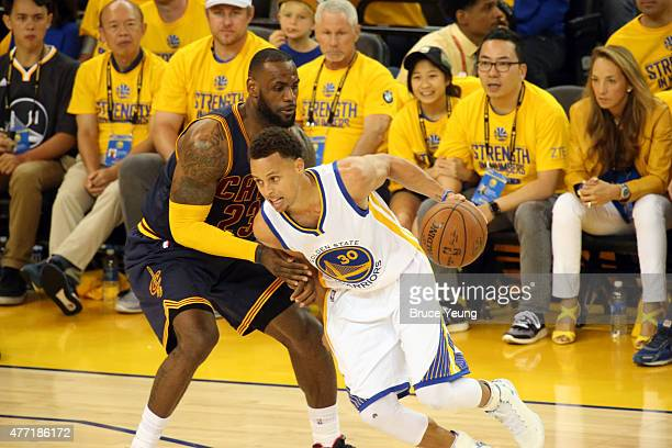 Stephen Curry of the Golden State Warriors drives to the basket against LeBron James of the Cleveland Cavaliers in Game Five of the 2015 NBA Finals...