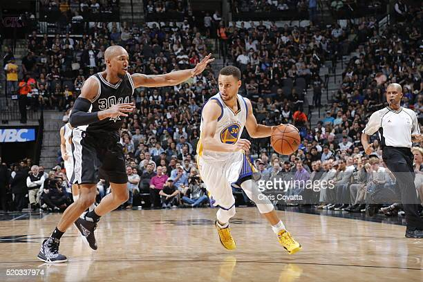 Stephen Curry of the Golden State Warriors drives to the basket against David West of the San Antonio Spurs on April 10 2016 at the ATT Center in San...
