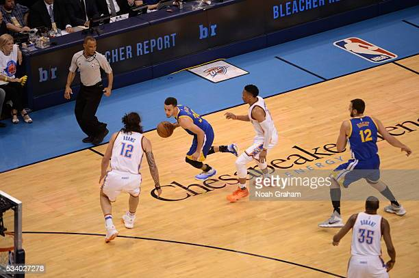 Stephen Curry of the Golden State Warriors drives to the basket against Steven Adams of the Oklahoma City Thunder in Game Four of the Western...
