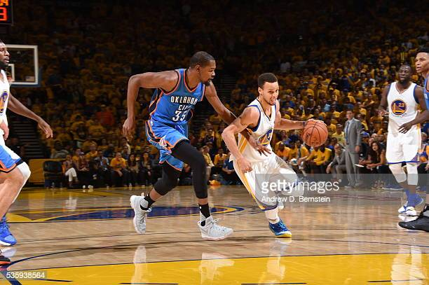 Stephen Curry of the Golden State Warriors drives to the basket against Kevin Durant of the Oklahoma City Thunder during Game Seven of the Western...