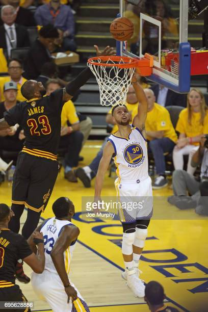 Stephen Curry of the Golden State Warriors drives to the basket around LeBron James of the Cleveland Cavaliers in Game Five of the 2017 NBA Finals on...