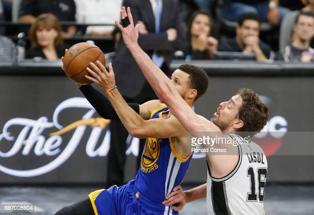 Stephen Curry of the Golden State Warriors drives to the basket against Pau Gasol of the San Antonio Spurs in the second half during Game Four of the...