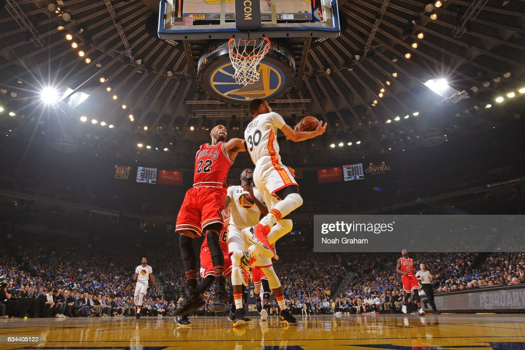 Stephen Curry #30 of the Golden State Warriors drives to the basket around Taj Gibson #22 of the Chicago Bulls on February 8, 2017 at ORACLE Arena in Oakland, California.