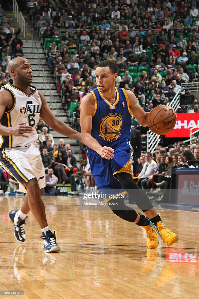 Stephen Curry #30 of the Golden State Warriors drives to the basket against the Utah Jazz at Energy Solutions Arena on February 19, 2013 in Salt Lake City, Utah.