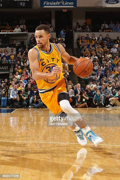 Stephen Curry of the Golden State Warriors drives to the basket against the Indiana Pacers on December 8 2015 at Bankers Life Fieldhouse in...