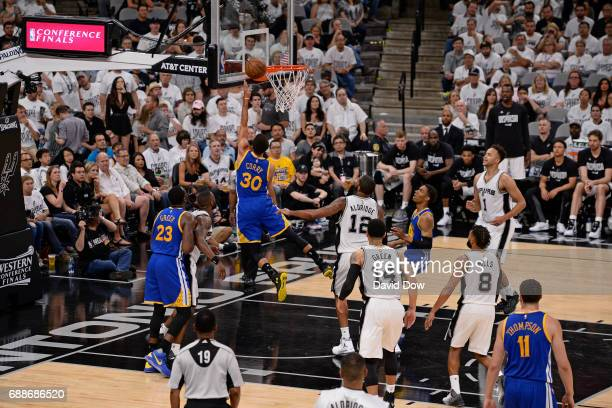 Stephen Curry of the Golden State Warriors drives to the basket against the San Antonio Spurs in Game Four of the Western Conference Finals during...