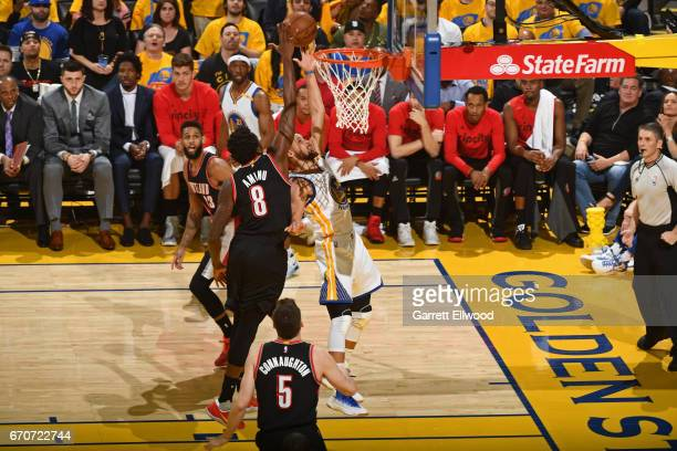 Stephen Curry of the Golden State Warriors drives to the basket while defended by AlFarouq Aminu of the Portland Trail Blazers during the Western...