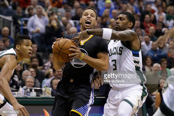 Stephen Curry of the Golden State Warriors drives to the hoop during the first quarter against the Milwaukee Bucks at BMO Harris Bradley Center on...